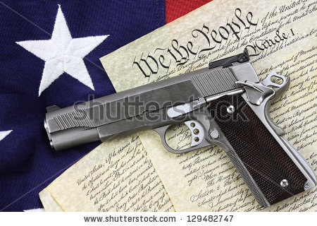 stock-photo-handgun-lying-over-a-copy-of-the-united-states-constitution-and-the-american-flag-129482747