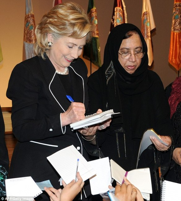 US Secretary of State Hillary Clinton (2nd L) is pictured with Saleha Mahmood Abedin (3rd L) at a women's college in Jeddah on February 16, 2010