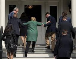 Hillary Helped Up Stairs