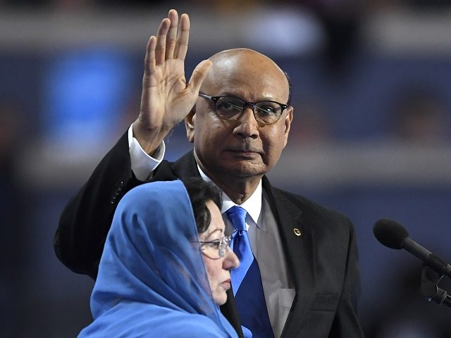 Khizr Khan, father of fallen US Army Capt. Humayun S. M. Khan waves as he stands near the podium before speaking during the final day of the Democratic National Convention in Philadelphia , Thursday, July 28, 2016. (AP Photo/Mark J. Terrill)