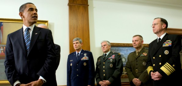 090128-N-0696M-200 WASHINGTON (Jan. 28, 2009) President Barack Obama, with, from left, Gen. Norton Schwartz, Air Force chief of staff; Gen. George W. Casey, U.S. Army chief of staff; Gen. James E. Cartwright, vice chairman of the Joint Chiefs of Staff and Adm. Mike Mullen, chairman of the Joint Chiefs of Staff, addresses the media during his first visit to the Pentagon since becoming commander-in-chief. Obama and Vice President Joe Biden met with Secretary of Defense Robert M. Gates and all the service chiefs for their input on the way ahead in Afghanistan and Iraq. (U.S. Navy photo by Mass Communication Specialist 1st Class Chad J. McNeeley/Released)